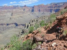 Grand Canyon National Park, AZ, USA: Hermit Trail / Hiker nearing Cathedral Stairs while descending the Hermit Trail.