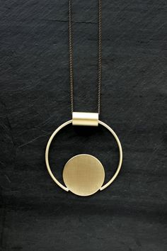 Be the envy of your creative circle! The Eloria Large Brass Circle Necklace features a formed and soldered brass pendant on a brass or brass and sterling silver chain. The tube and bail remain unfixed, allowing for free and abstract movement of th. Crystal Jewelry, Wire Jewelry, Jewelry Sets, Sterling Silver Jewelry, Antique Jewelry, Vintage Jewelry, Jewelry Necklaces, Silver Ring, Silver Earrings