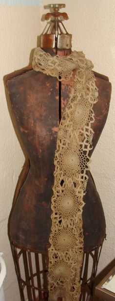 A vintage dress-form or mannequin would be a perfect way to display and store ones favourite scraves.