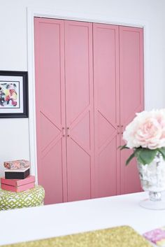 Folding Pink Closet Doors Bedroom via Monica Wants It