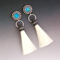 White Horse Hair Tassel Earrings with sterling silver real opal and silver hoops. via Etsy.