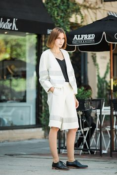 Any weather is leather weather. Ania B wears Tibi's Detailed Leather Jacket and coordinating Detailed Leather Pleated Culottes.