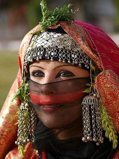 Yemeni girl wearing a traditional bride costume