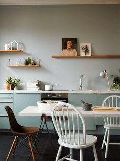 Pale mint kitchen cabinets, open shelving, mismatched chairs // Remodeling Resources: Best Open Kitchen Storage Shelves | Apartment Therapy