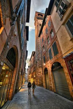 Explore Lucca's elegant streets.