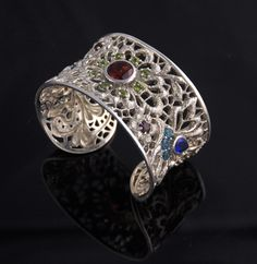 Lydia Lerner Lace Flower Gemstone Cuff    Made in Bali    Sapphire, Peridot, Garnet, Champagne Citrine, Blue Topaz & Rubies    Handmade & handset stones    Sterling silver    80g    Measures 1 1/8″ wide
