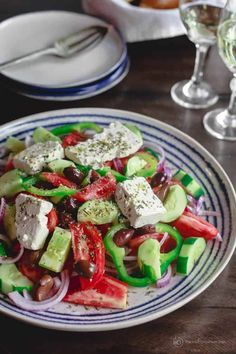 BEST Traditional Greek Salad Recipe! This tastes just as they make it on the Greek islands and villages. Grab the tips with this recipe. #greekfood #greeksalad #greeksaladdressing #greekrecipes #mediterraneandiet #mediterraneandietrecipes #mediterraneanfood #salad #healthysalad #feta