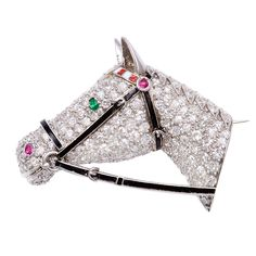 Diamond Horse Head Brooch ~ Pavé diamond set horse head brooch in platinum with a black enamel bridal, a ruby and white enamel headband and an emerald eye. Equestrian Jewelry, Horse Jewelry, Insect Jewelry, Animal Jewelry, Gemstone Brooch, Diamond Brooch, Diamond Gemstone, Antique Jewelry, Vintage Jewelry