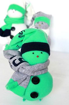 DIY SOCK SNOWMAN TUTORIAL - Love upcycling? Use some socks to create fun, adorable Christmas ornaments with this insanely easy DIY sock snowman tutorial.