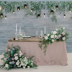 Wedding Sweetheart Table Inspiration for your wedding day decor. This unique sweetheart table is perfect for your garden style wedding. The dusty pink is paired perfectly with the asymmetrical greenery and flower sweetheart table flowers. Head Table Backdrop, Head Table Decor, Head Tables, Backdrop Decorations, Wedding Flower Decorations, Decoration Table, Wedding Flowers, Backdrop Ideas, Sweetheart Table Backdrop