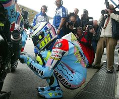 Valentino Ross: rare shot of his prayer in this livery.  Assen 2007.  Started 11th on the grid, won the race.