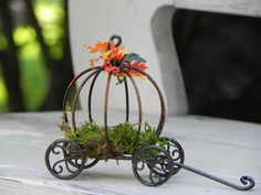 This whimsical wire pumpkin carriage is sure to be the focal point of your seasonal miniature garden! Its one of my favorites.  Adorned with