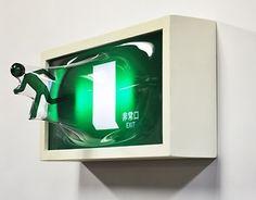 We like the artistic exit sign by Yuki Matsueda. We wish we could use it in our fire doors.   Nos gusta esta artistica señal de emergencia de Yuki Matsueda. Nos gustaria poder usarla junto a nuestras puertas cortafuego.