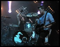 Dave Grohl and Josh Homme . I could die happy after seeing them