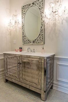 Art Deco Powder Room with Howard Elliott Regina Mirror, Adelina 36 inch Mirrored Bathroom Vanity Imperial White Marble Top