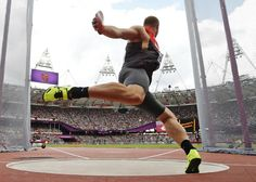 Germany's Robert Harting takes a throw in a men's discus throw qualification round during the athletics in the Olympic Stadium at the 2012 Summer Olympics, London, Monday, Aug. 6, 2012. (AP Photo/Matt Dunham)