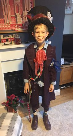 Hand made mad hatter costume for world book day. Hat made from cardboard covered in fabric & accessorised. Cotton reels on ribbon, waistcoat, scarfs, odd socks, cut legs off old trousers. 2017