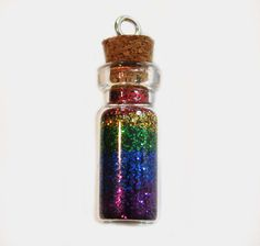 Rainbow In A Bottle Charm.  I found this looks just as effective with tiny glass seed beads but much less mess involved!