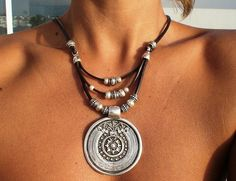 Leather necklace with bohemian silver pendant, tribal boho jewelry. An everyday fashion jewelry !! necklaces for women, silver jewelry, personalized leather jewelry, original designs by kekugi. This necklace is made of genuine leather and silver plated beads. All silver pieces are subjected to an anti-allergic process ( nickel and lead free) with a silver plating of 8 microns of sterling silver.  MADE TO ORDER ! I make this to be 16 40cm long ( shortest strand) , but all jewelry can be…