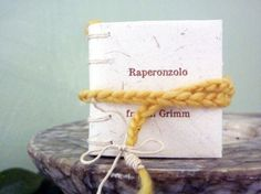 Rapunzel  mini book in elephant dung paper by Satyrika on Etsy, €12.00