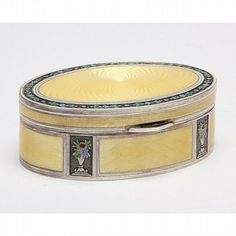 "Vintage silver and guilloche enamel box. oval form, c. 1920, Austrian, .900 silver content, with ""RS"" maker's mark (likely for Rudolf Steiner), bright butter yellow enamel; floral garland border to cover and floral bouquet side plaques. 1.25 x 3.5 x 2 3/8""."