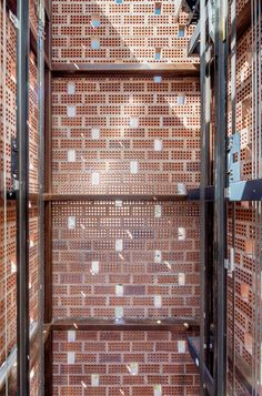 Featuring walls of perforated brickwork, this elevator is located in the Gironella municipality of Spain.