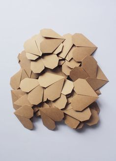 folded paper hearts by upon a fold