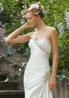 Wedding Gowns By Voyage featuring 6746 Crystal Beading on Soft Satin Colors Available: White/Silver, Ivory/Silver. Sizes Available: 2-28.