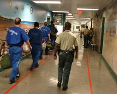 Men's Central Jail hallway escort. (Photo Credit: J.Williams)