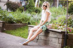 Chilling in the West Side Community Garden in New York City, Joe Fresh silk blouse, Zara tropical print shorts, J.Crew leopard print pouch, Sandro slip-on sneakers