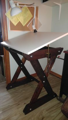 I wanted a drafting / drawing table to fit in my available space and couldn't find one commercially. So I built one.