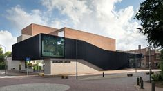 Amsterdam studio KRFT has updated and extended a museum and cultural complex in the Dutch town of Laren