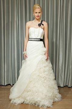 Ruffles spill out from an Alyne wedding dress, Fall 2013