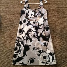 New York & company dress Dress with back zipper. Black white and gray flower design comes a little bit above the knee. Size 6 but runs big I am a size 8/10 usually but this fits me perfect New York & Company Dresses