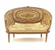 A Louis XVI needlepoint upholstered canape