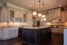 Kitchen cabinets with great finishing and leaded glass fronts. benjaminmarcushomes.com