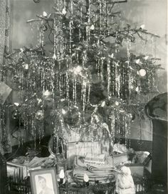 Appears to be Christmas during the WW II Era. Notice the framed photo of the soldier under the tree.