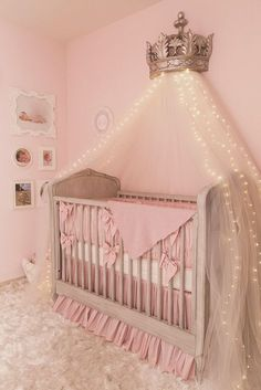AWESOME! Scrumptious pink Princess baby nursery.  Love the little LED lights in the netting!