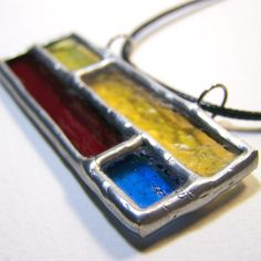 Brick by Brick - Stained Glass Pendant with Black Cord. $18.00, via Etsy.