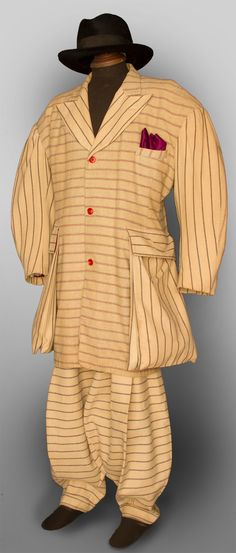 MAN'S WOOL ZOOT SUIT, N.J., 1938-1942 2 different pattern striped wools, long fitted coat, oversize padded shoulders & exterior pouch pockets, red plastic buttons, high-waist balloon pants, pegged cuffs, 4 slash pockets, crudely made suspenders in cinnamon wool