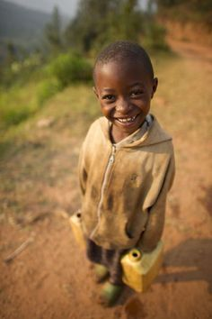 Ishimwe, 7, a neighbor to Ruli Washing Station, takes home water for her family. http://dogoodinitiative.org/areas-to-give/