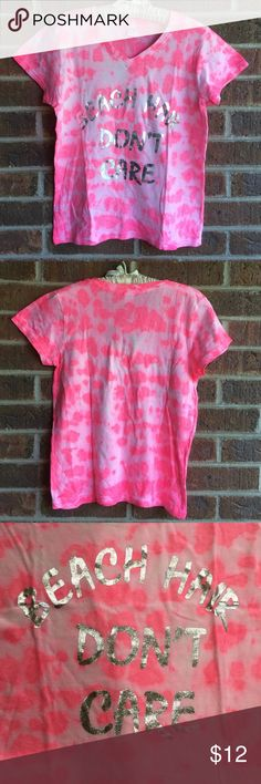 "NWT pink tie dye graphic tee shirt size L Pink tie dye with metallic silver graphics. ""BEACH HAIR DON'T CARE"" made from 100% cotton. Underarm to underarm 18 inches. Shoulder to bottom hem 23 1/2 inches. Tops Tees - Short Sleeve"