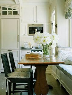 Dining table, with bench bacjed by kitchen island