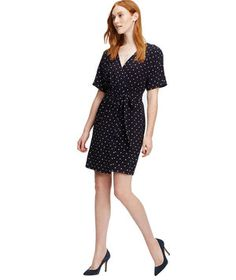 Oversized polka-dot prints can seem a bit childish, but on a smaller scale, they're sweetly sophisticated. Even better? The classic rule of black being the most minimizing color still applies here.