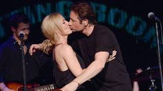 'X Files' actors David Duchovny and Gillian Anderson paid tribute to Mulder and Scully by kissing on stage. Anderson joined Duchovny on stage at the release party in New York for his album Hell or High Water — because of course David Duchovny made an album — and planted one on him while the crowd freaked out. - 2 videos : mashable - 5/13/15
