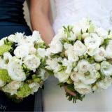 Bouquets featuring white David Austins, lisianthus and freesais, with green gildarose, and navy blue berry
