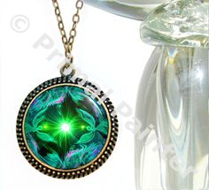 This is a green heart chakra necklace in my angel art collection of reiki jewelry. This bright, glowing green angel themed pendant necklace can be used for its reiki healing energy and uplifting vibes
