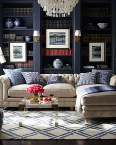 Deep blue-gray wall color is perfect backdrop for this neutral upholstered sectional and simply patterned rug.