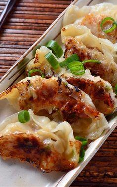 SPICY SESAME CHICKEN POTSTICKERS - garlic, green onions, jalapeno, sesame oil, soy sauce, rice vinegar, ginger, ground chicken...