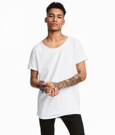 e16345a7773 Stock up on affordable t-shirts and tank tops for men from a wide selection  at H M. From basic white tees and polos to graphic prints, stripes, band  tees an